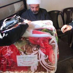قسم رعاية الأيتام في مكتب سماحة المرجع الكبير السيد الحكيم (مدّ ظله) في سوريا، يوزع المساعدات الشتوية أيتام الفوعة وكفريا القاطنين في مركز الإيواء في مدينة حسياء السورية